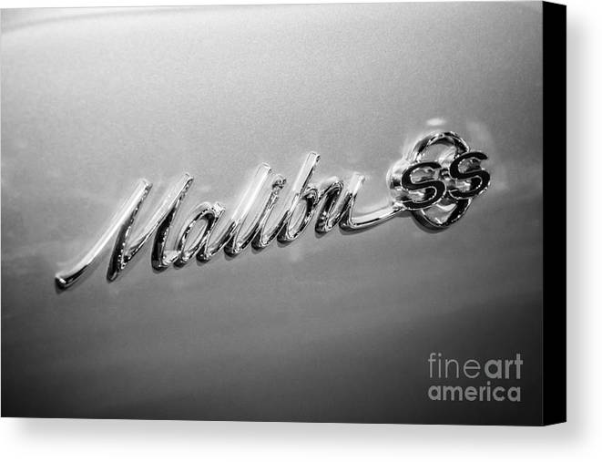 1960's Canvas Print featuring the photograph Chevrolet Malibu Ss Emblem Black And White Picture by Paul Velgos