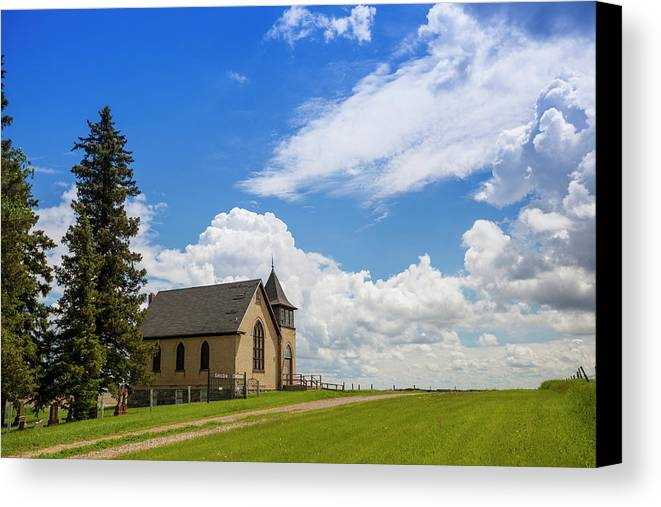 Road Canvas Print featuring the photograph Church On A Hill In A Rural Setting by Susan Dykstra
