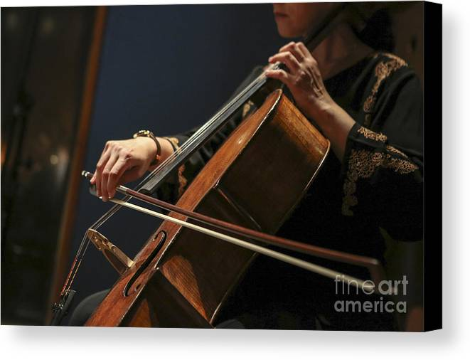 Cellist Canvas Print featuring the photograph Close Up Of The Cellist's Hands by Oren Shalev