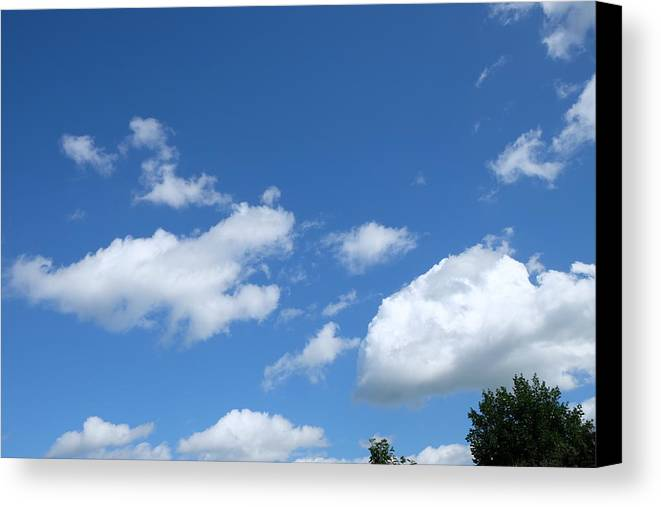 Sky Canvas Print featuring the photograph Clouds by Mark Severn