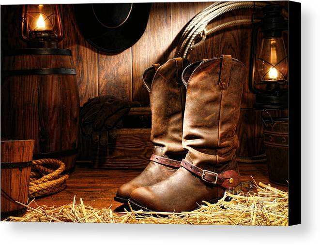 Western Canvas Print featuring the photograph Cowboy Boots In A Ranch Barn by Olivier Le Queinec