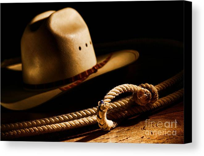 Western Canvas Print featuring the photograph Cowboy Hat And Lasso by Olivier Le Queinec