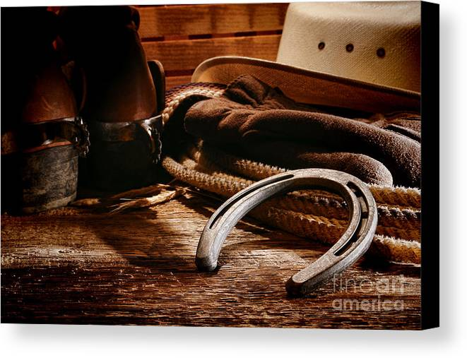 Western Canvas Print featuring the photograph Cowboy Horseshoe by Olivier Le Queinec