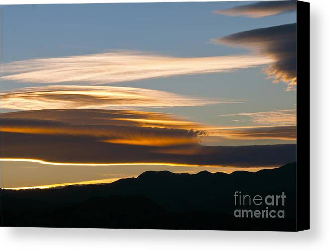 Death Valley National Park California Sunset Sunsets Cloud Color Evening Sky Colors Clouds Mountain Mountains Landscape Landscapes Canvas Print featuring the photograph Death Valley Evening Sky by Bob Phillips