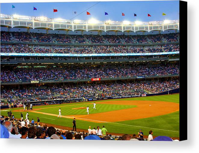 Yankees Canvas Print featuring the photograph Derek Jeter Leads The Way As The Yankees Take The Field by Aurelio Zucco