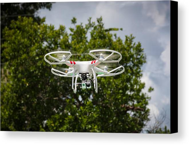 Dji Canvas Print featuring the photograph Dji Phantom 2 Drone With Go Pro Hero 3 by Rich Franco