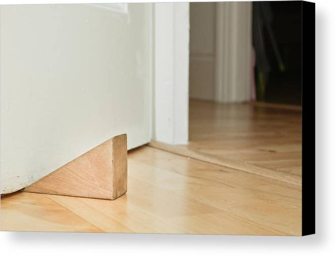 Board Canvas Print featuring the photograph Door Stopper by Tom Gowanlock