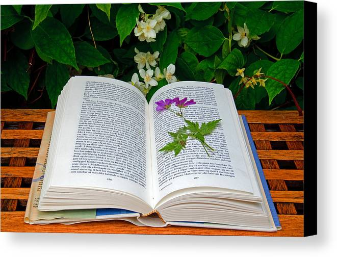 Book Canvas Print featuring the photograph Dried Flower In A Book by Gry Thunes