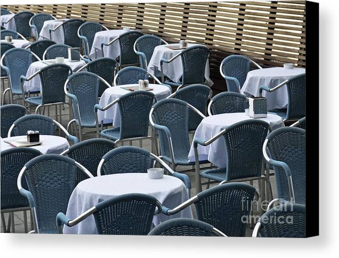 Blue Canvas Print featuring the photograph Empty Restaurant Seats And Tables by Sami Sarkis