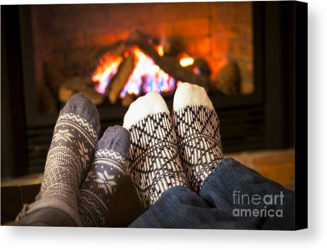 Feet Canvas Print featuring the photograph Feet Warming By Fireplace by Elena Elisseeva
