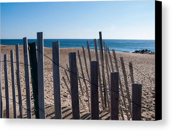 Ocean Canvas Print featuring the photograph Fence Sand And Ocean by Eryn Carter
