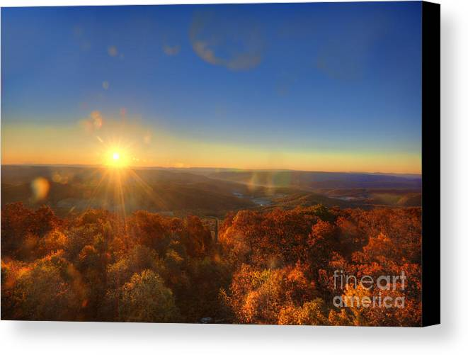 Morning Canvas Print featuring the photograph First Morning Light Striking Top Of Trees by Dan Friend