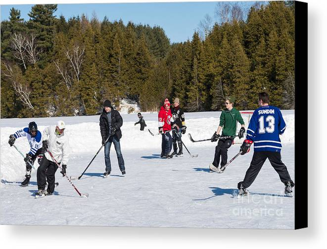 Ice Canvas Print featuring the photograph Game Of Ice Hockey On A Frozen Pond by Les Palenik