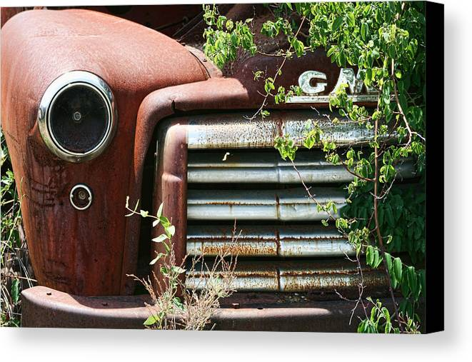 Gmc Canvas Print featuring the photograph Gmc Grill Work by Kathy Clark