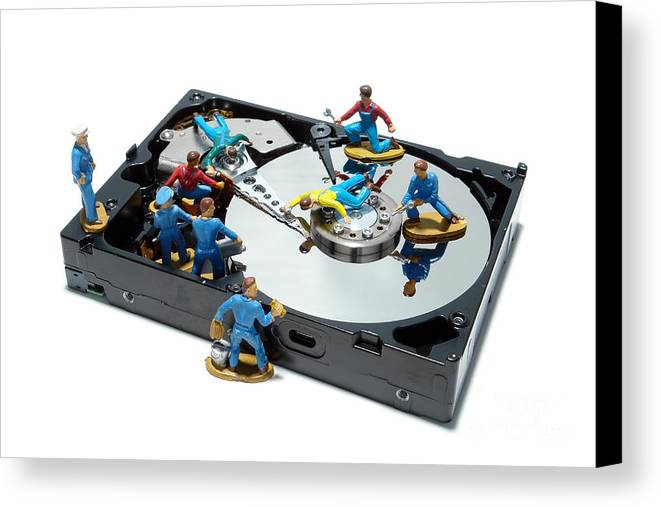 Computer Canvas Print featuring the photograph Hard Drive Maintenance by Olivier Le Queinec