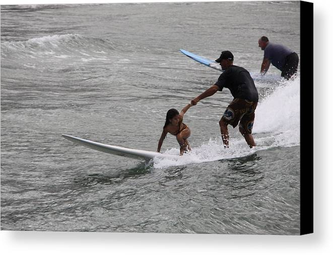 Surfing Canvas Print featuring the photograph Hold On Dad by Dick Willis