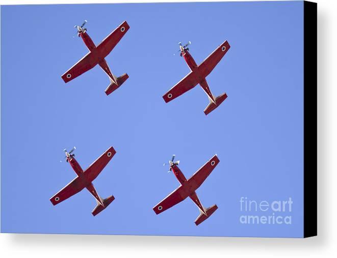 Acrobatic Canvas Print featuring the photograph Iaf Flight Academy Aerobatics Team 4 by Nir Ben-Yosef