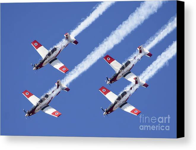 Acrobatic Canvas Print featuring the photograph Iaf Flight Academy Aerobatics Team 6 by Nir Ben-Yosef