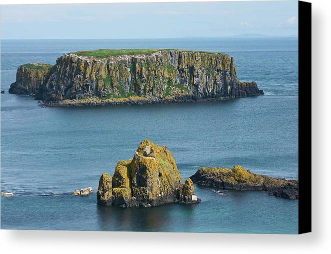 Rock Formation Canvas Print featuring the photograph Island Off The Coast Near Ballintoy by Carl Bruemmer