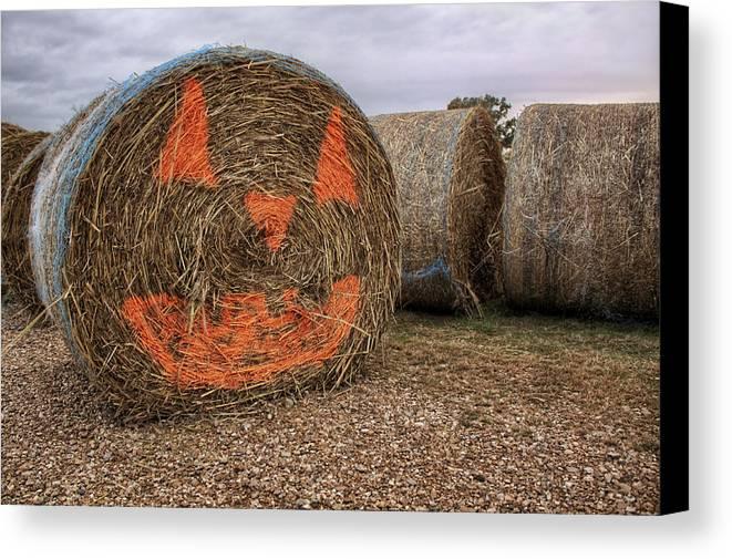 Halloween Canvas Print featuring the photograph Jack-o-lantern Hayroll by Jason Politte
