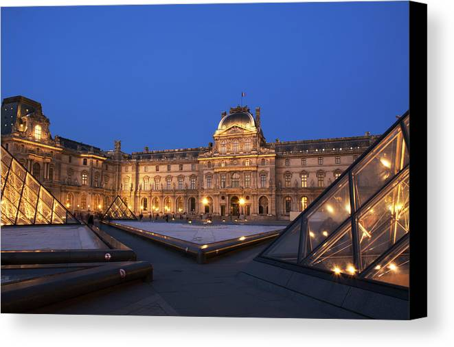 Clear Sky Canvas Print featuring the photograph Le Louvre Palace Buildings And Pyramids by Philippe Widling