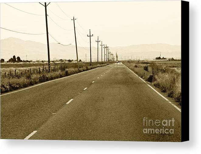 Road Picture Canvas Print featuring the photograph Long Road Home by Artist and Photographer Laura Wrede