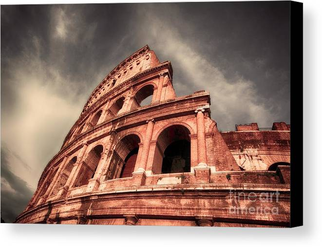 Rome Canvas Print featuring the photograph Low Angle View Of The Roman Colosseum by Stefano Senise