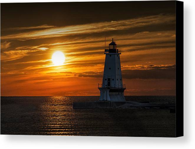 Art Canvas Print featuring the photograph Ludington Pier Lighthead At Sunset by Randall Nyhof