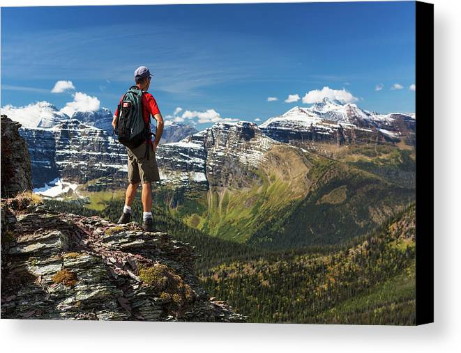 Hiker Canvas Print featuring the photograph Male Hiker Standing On Top Of Mountain by Michael Interisano
