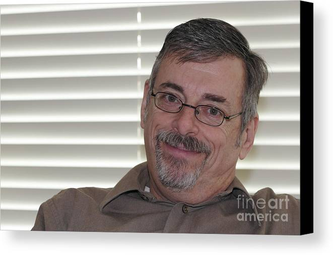 Mature Canvas Print featuring the photograph Mature Man Looking At Viewer by Lee Serenethos