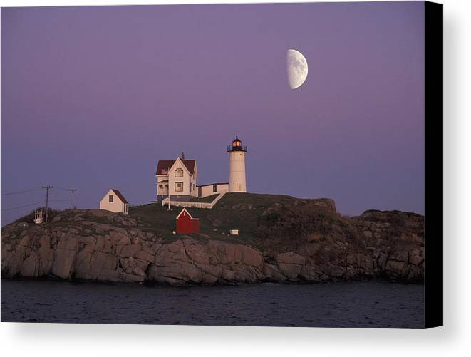 Moon Canvas Print featuring the photograph Nubble Light by Christian Heeb