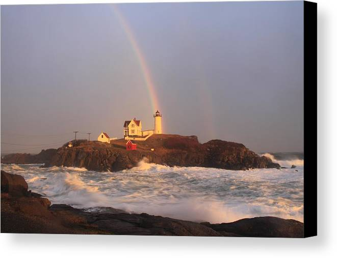 Lighthouse Canvas Print featuring the photograph Nubble Lighthouse Rainbow And High Surf by John Burk