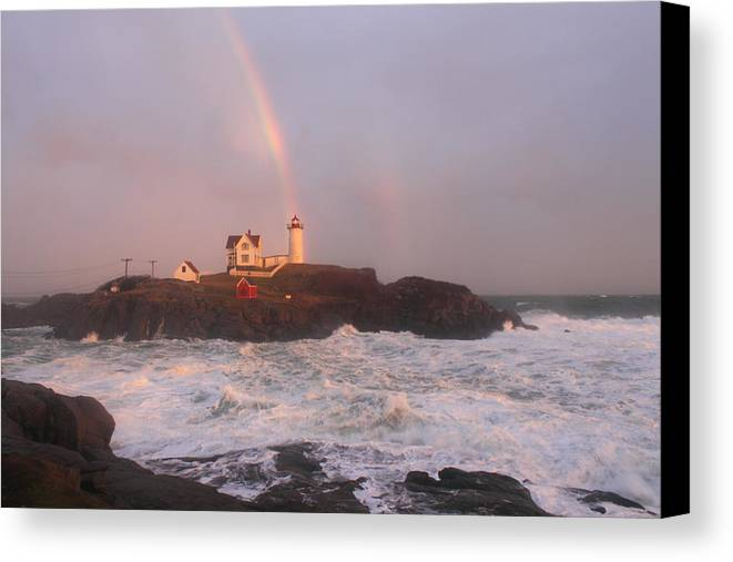 Lighthouse Canvas Print featuring the photograph Nubble Lighthouse Rainbow And Surf At Sunset by John Burk