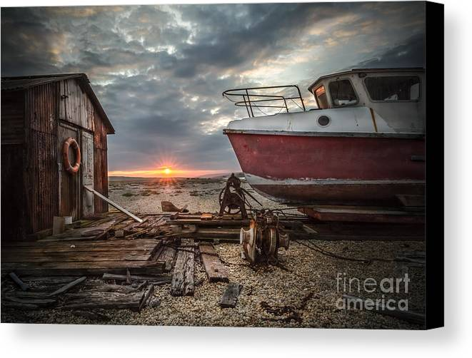 Sunset Canvas Print featuring the photograph Old Boat At Sunset by Ivor Toms