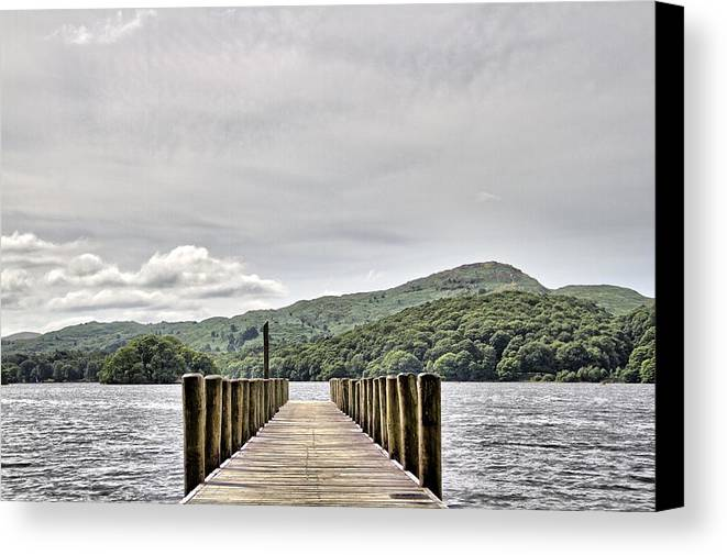 Pier Canvas Print featuring the photograph On The Pier by Graham Roberts