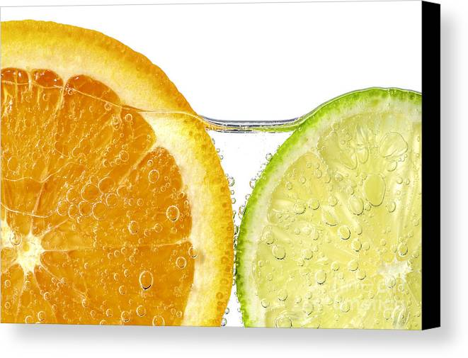 Orange Canvas Print featuring the photograph Orange And Lime Slices In Water by Elena Elisseeva