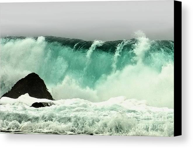 Crashing Wave Canvas Print featuring the photograph Pebble Beach Crashing Wave by Artist and Photographer Laura Wrede