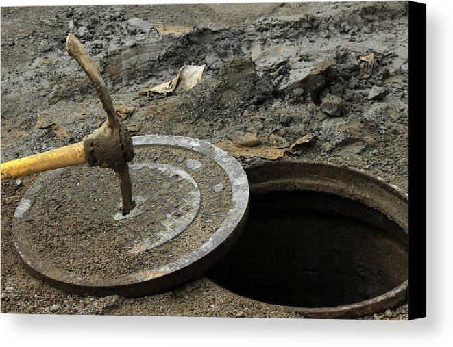 Pick Axe Canvas Print featuring the photograph Pick Axe In A Man Hole Cover by Robert Hamm
