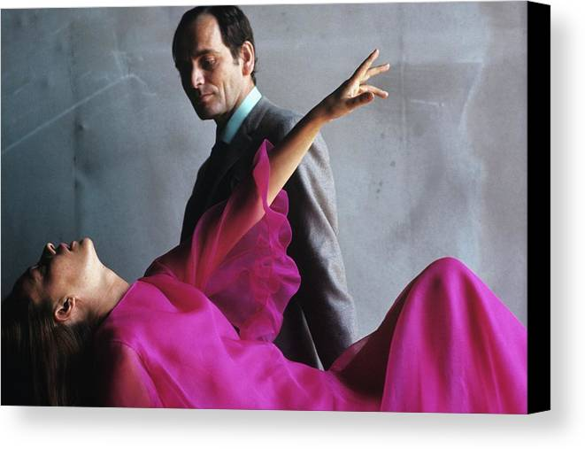 Actress Canvas Print featuring the photograph Portrait Of Jeanne Moreau And Pierre Cardin by Bert Stern