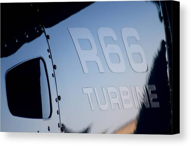 Robinson's R66 Turbine Helicopter Canvas Print featuring the photograph R66 Reflection by Paul Job