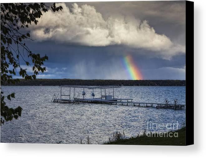 Michigan Canvas Print featuring the photograph Rainbow At Burt Lake by Timothy Hacker