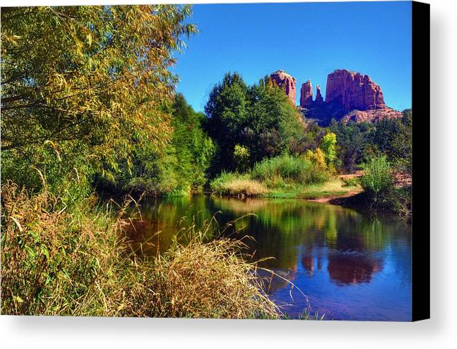 Blue Trees Sky Reflections Nature Red Rocks Water Outdoors Sedona Arizona Northern Cliffs Bushes Grass Color Beauty Canvas Print featuring the photograph Red Rock Crossing by Thomas Todd