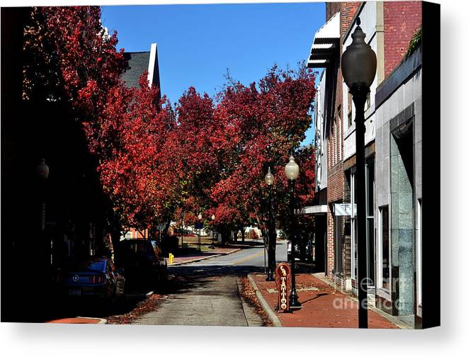 Canvas Print featuring the photograph Red Street by Trevor DeNicholas