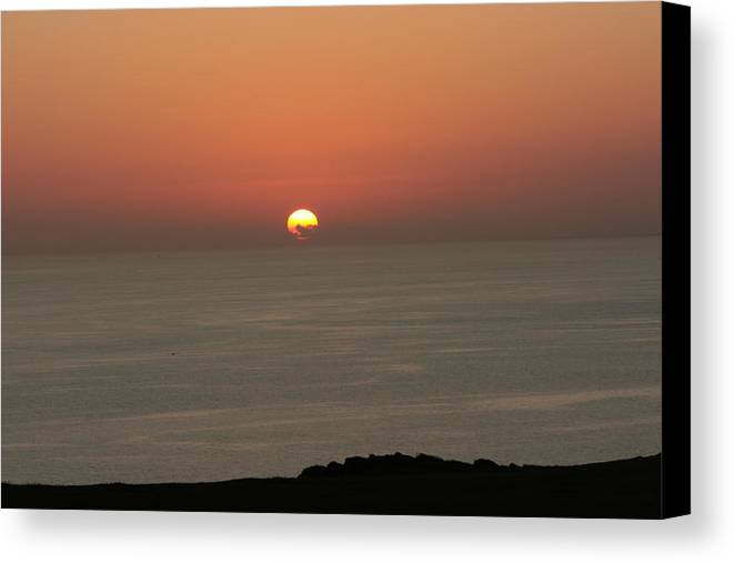 Red Sunset Over Sea Canvas Print featuring the photograph Red Sunset Over Sea by Gordon Auld