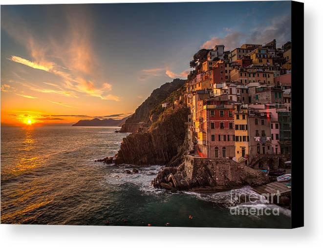 Riomagiore Canvas Print featuring the photograph Riomaggiore Rolling Waves by Mike Reid