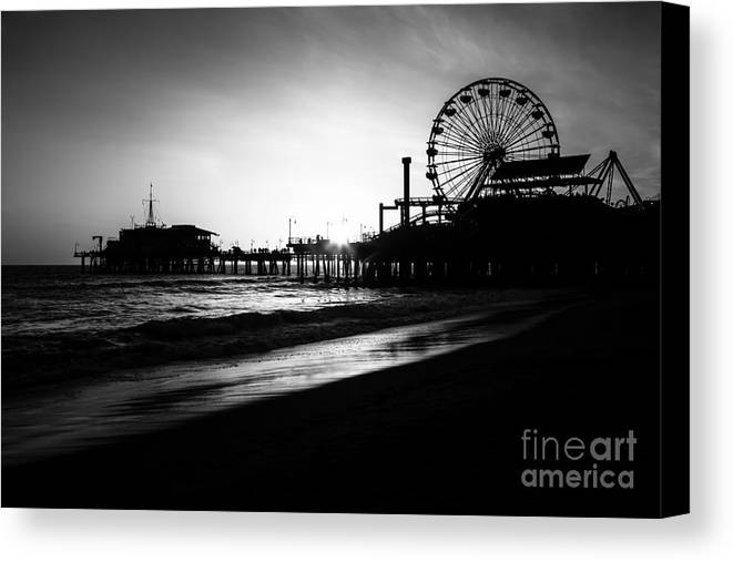 America Canvas Print featuring the photograph Santa Monica Pier In Black And White by Paul Velgos