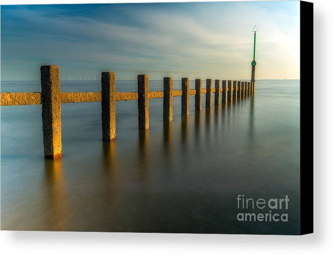 Groynes Canvas Print featuring the photograph Seascape Wales by Adrian Evans