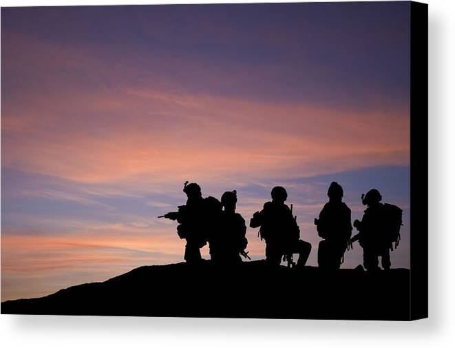Army Canvas Print featuring the photograph Silhouette Of Modern Troops In Middle East Silhouette Against Be by Matthew Gibson