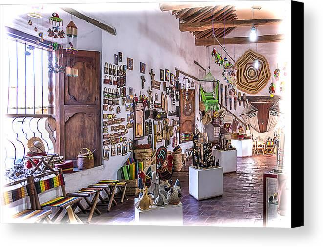 Art Canvas Print featuring the photograph Souvenir Shop by Maria Coulson