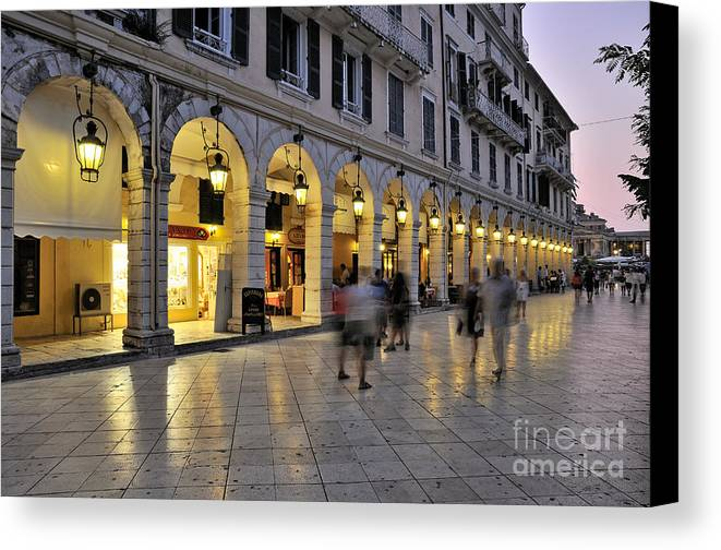 Corfu; Kerkyra; Old; City; People; Tourists; Walk; Walking; Dusk; Twilight; Lights; Spianada; Square; Ionion; Ionian; Greece; Hellas; Greek; Hellenic; Island; Europe; Prints Canvas Print featuring the photograph Spianada Square During Dusk Time by George Atsametakis